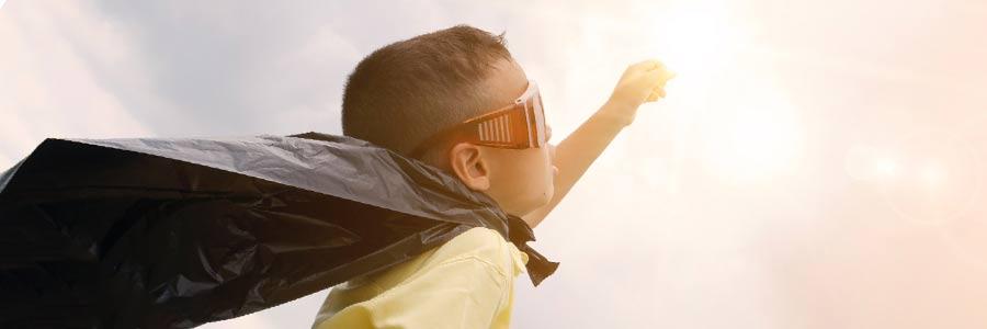 Startup Symbolbild: Kind als Superheld